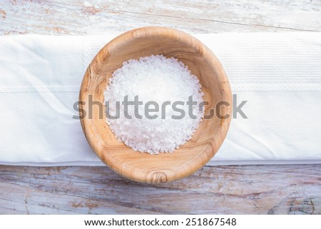 Salt in wooden bowl - stock photo