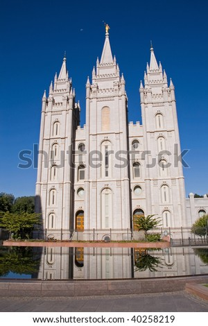 Salt Lake City Temple, reflection in the water and the Moon on the morning blue sky - stock photo