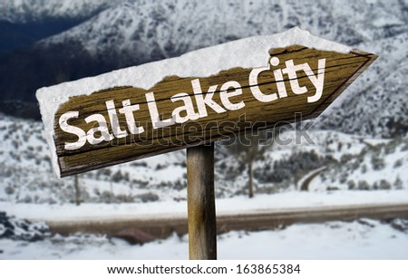 Salt Lake City , USA , America wooden sign with a snow background - stock photo