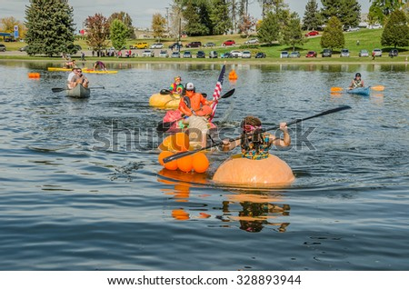 SALT LAKE CITY, UT - OCTOBER 17: People dressed up and participating in the 5th Annual Ginormous Pumpkin Regatta 2015 at Sugarhouse Park on October 17, 2015 in Salt Lake City, Utah. One is sinking. - stock photo