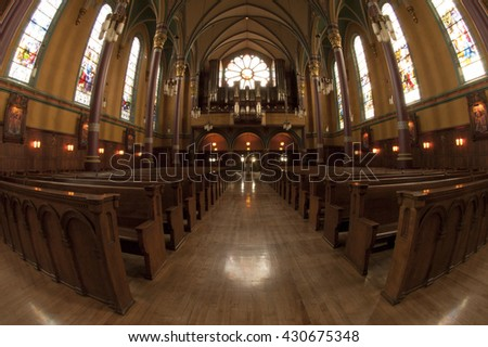SALT LAKE CITY, UTAH, USA - 12 OCTOBER 2005:  Looking down the nave towards the rose window of the Cathedral of the Madeline in Salt Lake City.  Fish eye lens.