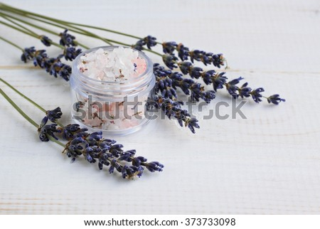 Salt or sugar herbal body scrub with lavender dried flowers. - stock photo