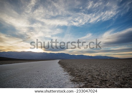 Salt pans of the Badwater basin, the 85.5 meters below sea level. Death Valley, USA - stock photo
