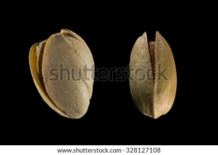 Salt pistachio on the black background - stock photo