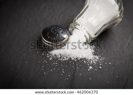 Salt shaker on slate board