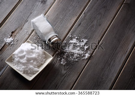 salt shaker on wooden table