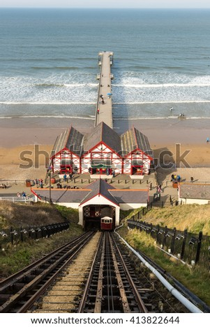 Saltburn-by-the-Sea, UK - April 10: The world's oldest water-powered funicular (cliff lift) and pier on April 10, 2016 in Saltburn-By-The-Sea  - stock photo