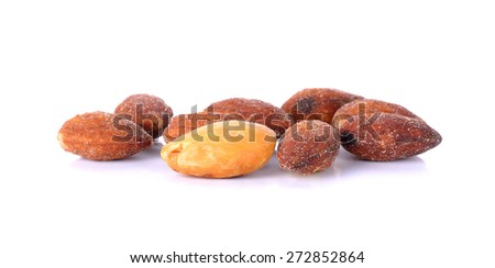 salted and roasted almonds on white background. - stock photo