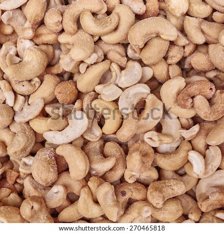 salted and tasted cashews close up, vegan food background - stock photo
