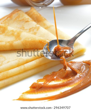 salted caramel and pancakes on a white plate