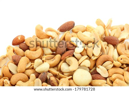 salted cocktail nuts on white background