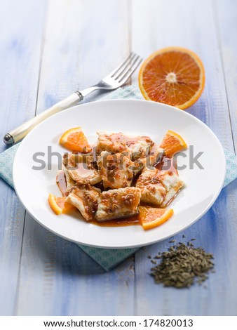 salted cod with orange juice and fennel seeds, selective focus