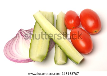 salted cucumber, red cherry tomatoes and sliced red onion on white, traditional snack while drinking vodka