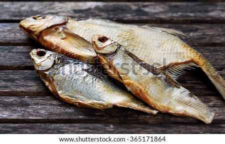 Salted Dry fish vobla on wooden table. - stock photo