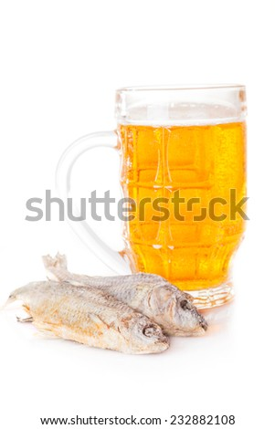 salted fish and a glass of beer - stock photo