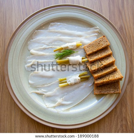 Salted fresh lard (salo) and marinated wild garlic  with toasted rye bread - stock photo
