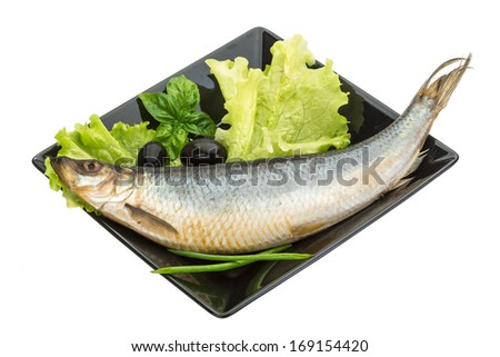 shrimps herring salad with onion and marinated artichoke hearts salad