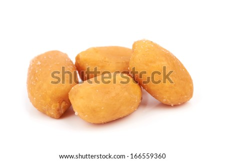 salted peanuts isolated on a white background - stock photo