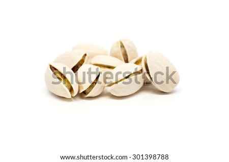 Salted pistachio nuts isolated on white background - stock photo