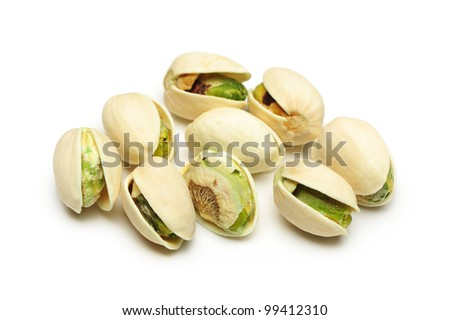 salted pistachio nuts on white background