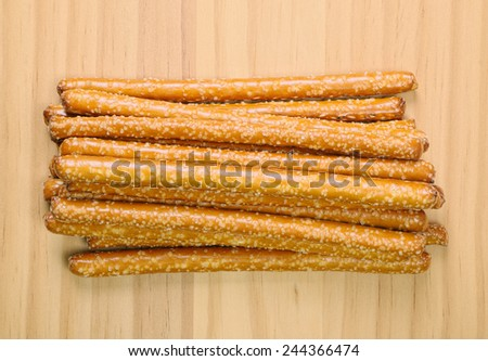 Salted Pretzel Rods in Pile on Table - stock photo