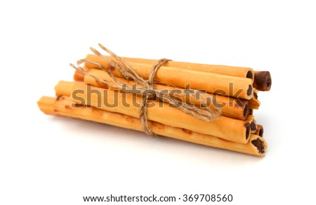 salted pretzel sticks in two rows on a white background - stock photo