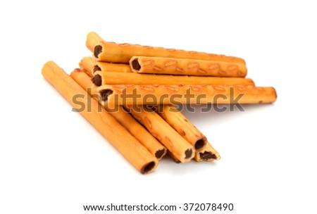 salted pretzel sticks isolated on white - stock photo