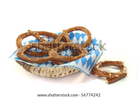 salted pretzels in a basket on a white background