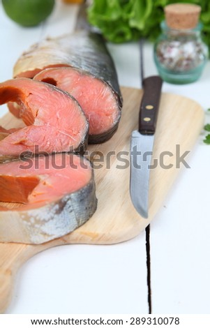 Salted red fish on a wooden table