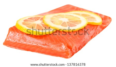 Salted salmon fillet and lemon slices isolated on white background - stock photo