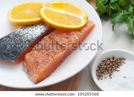 Salted salmon fillets with oranges - stock photo