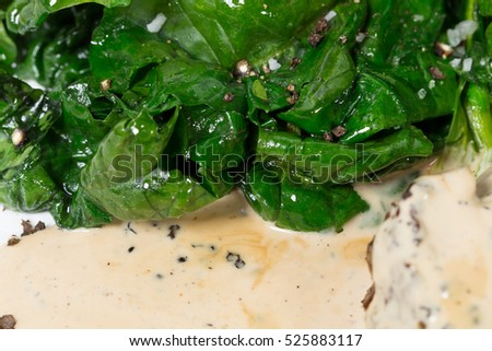 Salted spinach as a garnish for pork fillet. Macro. Photo can be used as a whole background.