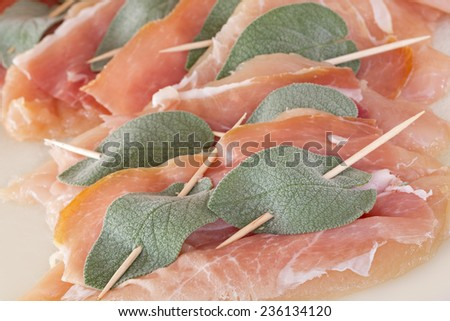 Saltimbocca with chicken, ham and sage leaves, uncooked - stock photo