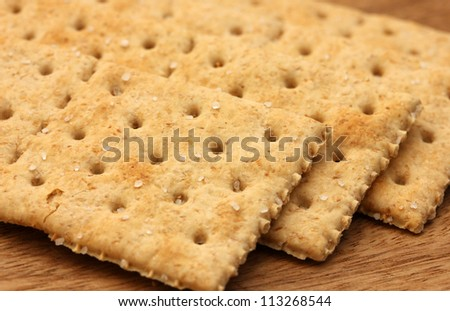 saltine wholemeal cracker biscuits - stock photo