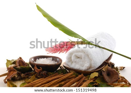 salts in bowl ginger flower on towel and pile of cinnamon  - stock photo