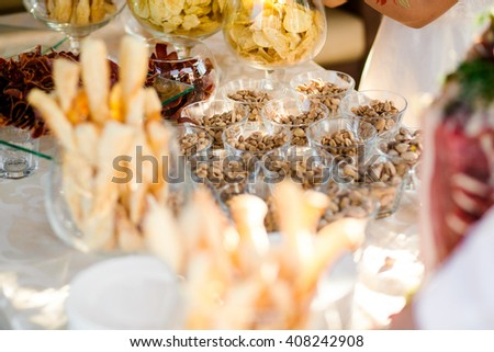 Salty and spicy food on the wedding table - stock photo