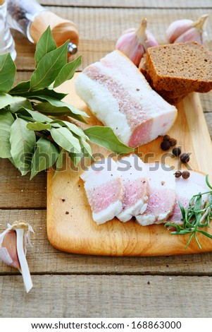 salty bacon with bread and spices, food closeup - stock photo