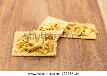 Salty crackers in square shape on white background - stock photo