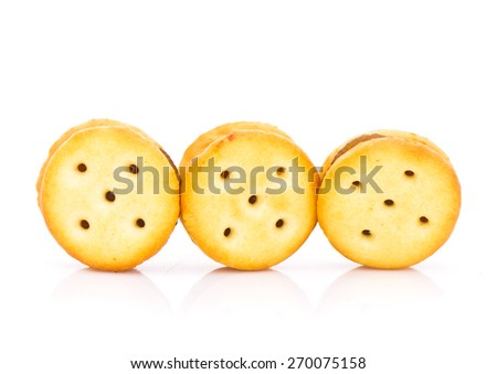 salty crackers stuffed with pineapple jam on white background - stock photo