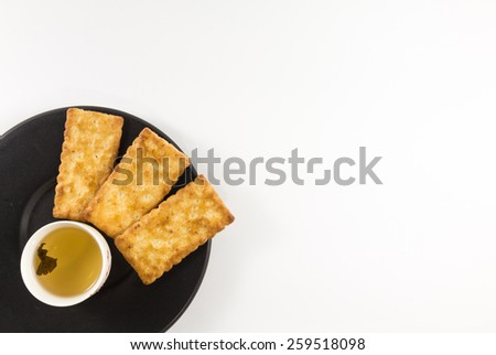 Salty Crackers With Tea - stock photo
