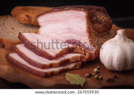salty lard on the cutting board - stock photo