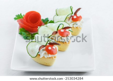 Salty mini tartlets stuffed with cream cheese and  vegetable  - stock photo