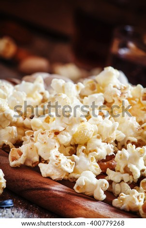 Salty popcorn - snack to beer or cola, selective focus - stock photo
