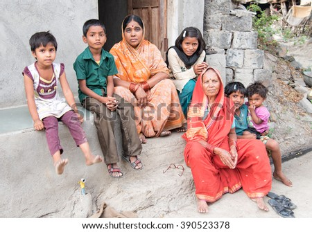SALUNKWADI, INDIA - July 11, 2015: ladies and children front of their house in rural village Salunkwadi, Ambajogai, Beed, Maharashtra, India, South East Asia.