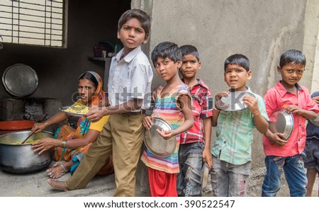 SALUNKWADI, INDIA - July 11, 2015: School children queue for mid day meal in rural village Salunkwadi, Ambajogai, Beed, Maharashtra, India, South East Asia.