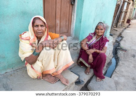 SALUNKWADI, INDIA - November 26, 2015: Ladies relaxing front of their home in rural village Salunkwadi, Ambajogai, Beed, Maharashtra, India, South East Asia.