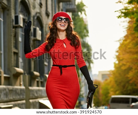 salutation of young woman in the city - stock photo