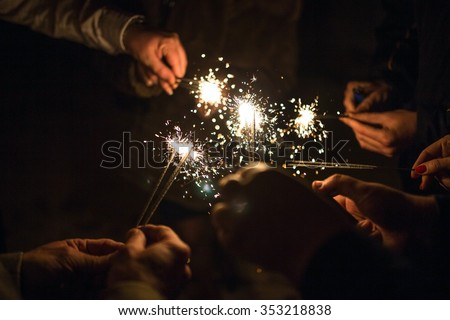 salute. fireworks. sparklers. People burn sparklers on holiday. - stock photo