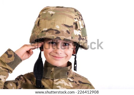 Saluting soldier. Young boy dressed like a soldier isolated on white - stock photo