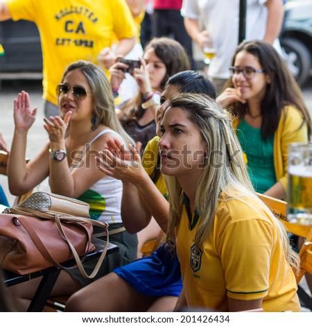 Salvador, Bahia, Brazil - June 28: Group of Brazilian girls watching World Cup football match on TV at a bar in Salvador, Bahia, Brazil. - stock photo
